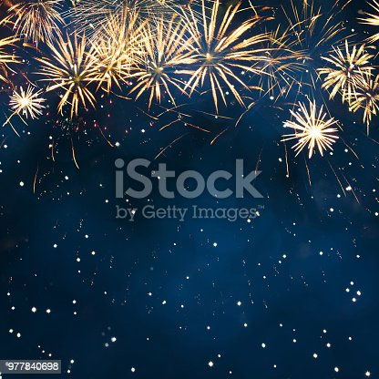 977840698 istock photo Holiday background with fireworks. 977840698