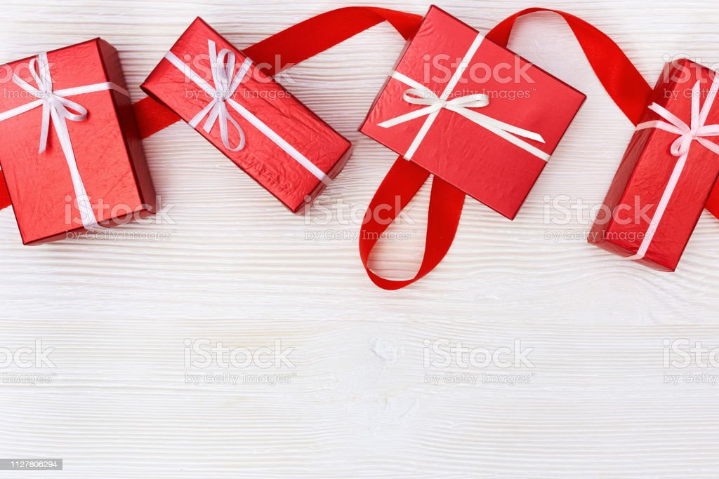 Holiday Background With Gifts Red Gifts On White Wood Presents For