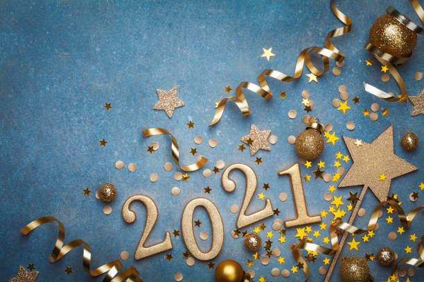 holiday background with golden christmas decorations and new year 2021 numbers and confetti top view. - happy new year imagens e fotografias de stock