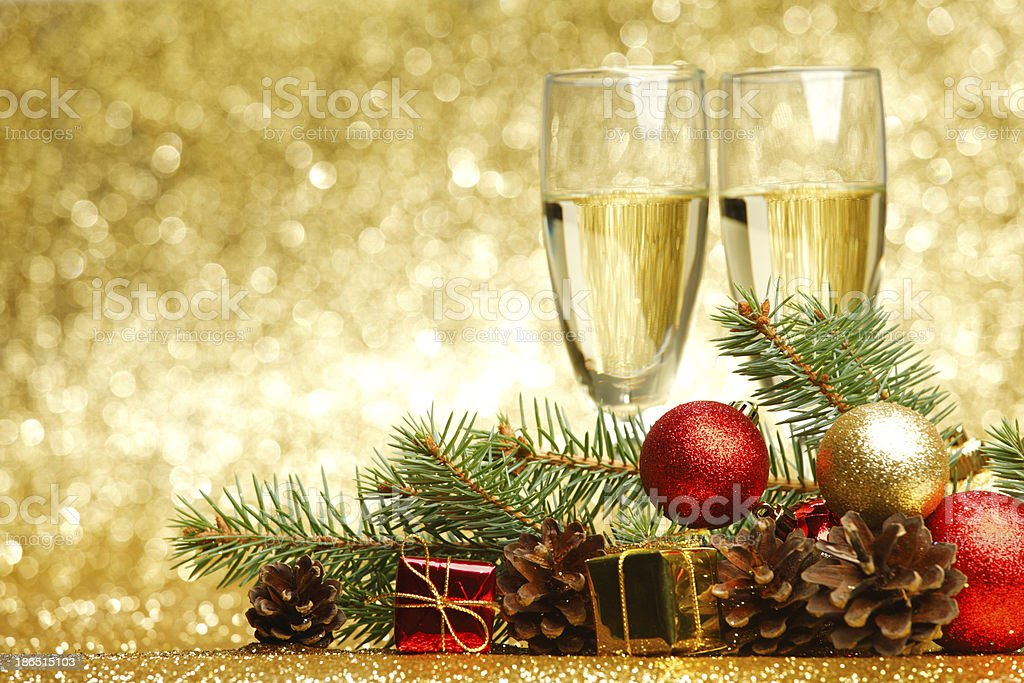 Holiday background with ornaments and champagne glasses royalty-free stock photo