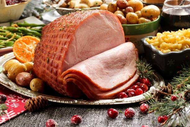 Holiday baked Ham with sides  / Xmas Dinner  table setting, selective focus stock photo
