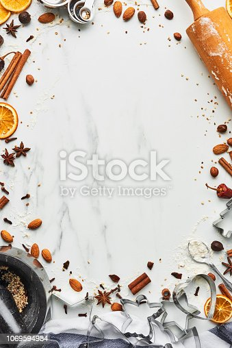 istock Holiday baking background for baking Christmas cookies with cutters 1069594984
