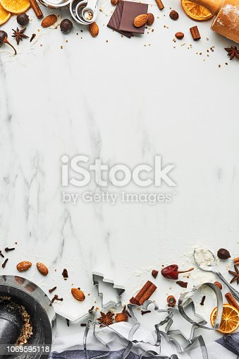 istock Holiday baking background for baking Christmas cookies with cutters 1069595118