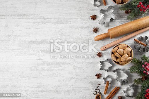 Christmas baking ingredients and objects on white wooden background