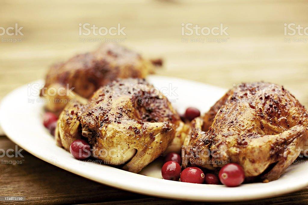 holiday basted cornish game hens on platter stock photo