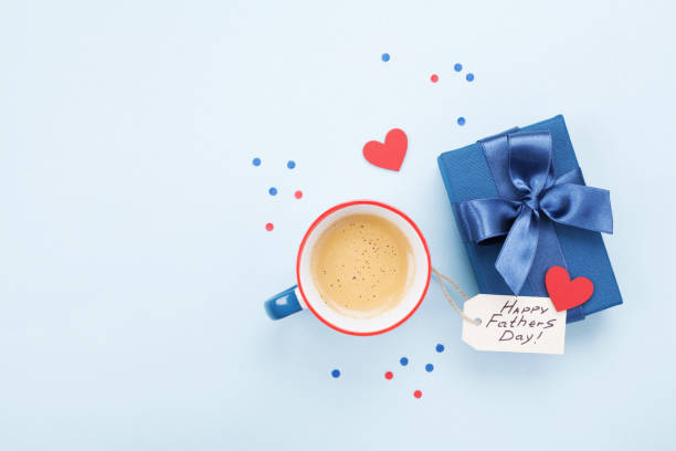 holiday breakfast on happy fathers day with coffee, gift box and heart on table top view. - fathers day stock photos and pictures