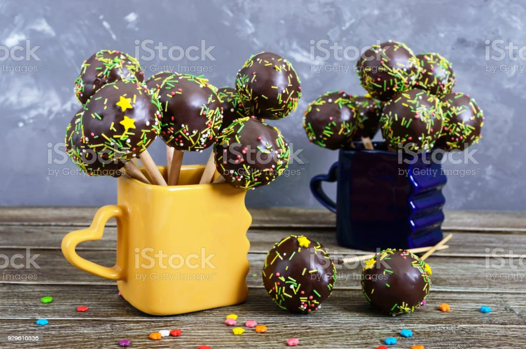Holiday Cake Pops Decorated With White And Black Chocolate In Cups On A Wooden Background Candy Stick