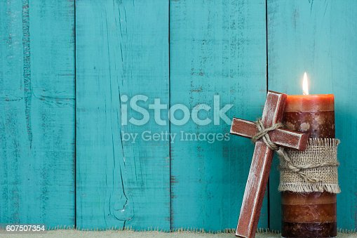istock Holiday candle and wood cross 607507354