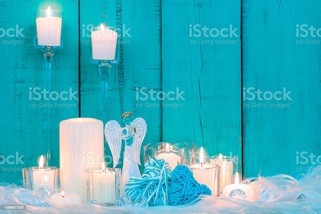 Holiday candles and decor with blue background stock photo