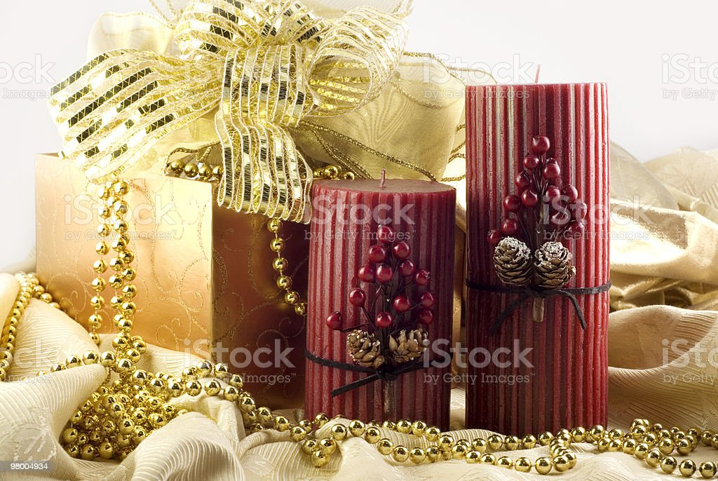 Holiday Candles with Gold Decorations royalty-free stock photo