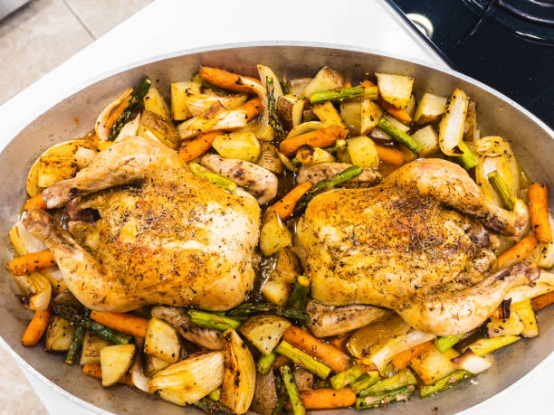 Holiday Celebration Oven Baked Cornish Game Hens Poultry and Vegetables Photo Series In Western Colorado Holiday Celebration Oven Baked Cornish Game Hens Poultry and Vegetables Photo Series Matching 4K Video Available (Shot with iPhone 12 Pro Max 12mp 4032×3024 photos professionally retouched - Lightroom / Photoshop -downsampled as needed for clarity and select focus used for dramatic effect) eyecrave stock pictures, royalty-free photos & images