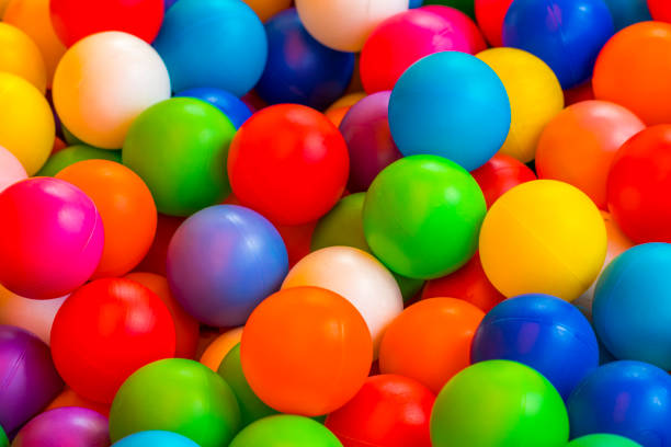 holiday, children's party, a games room, a box filled with small colored balls stock photo