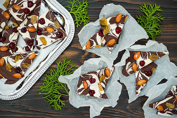 Holiday chocolate bark with dried fruits and nuts stock photo