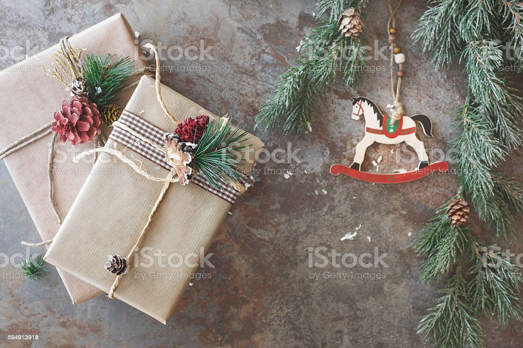 Two Christmas gifts and ornament on rustic board. Top view, vintage...