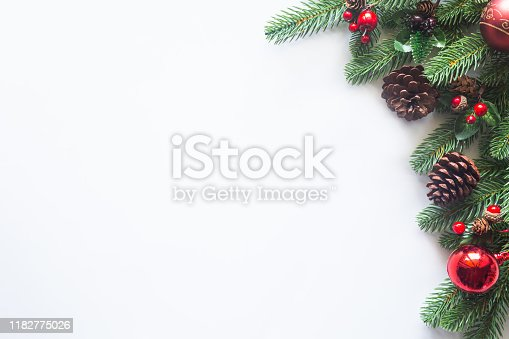 istock Holiday Christmas card background with festive decoration ball, stars, snowflakes, gift box, pine cones on a white background from Flat lay, top view. Space for text Merry Christmas and happy New Year 1182775026