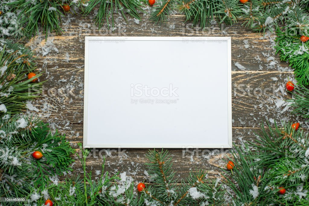 Holiday Christmas card with fir tree and festive decorations balls, stars, snowflakes on wood background. Christmas template for banner, ticket, leaflet, card, invitation, poster stock photo
