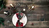 Holiday Christmas dining place setting on an old wood background