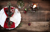 Holiday Christmas dining place setting on an old white wood table
