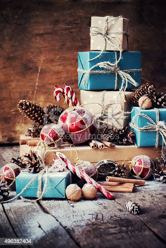 493890050 istock photo Holiday Christmas Gifts with Boxes, Twine, Balls, Fir Tree Toys 496382404