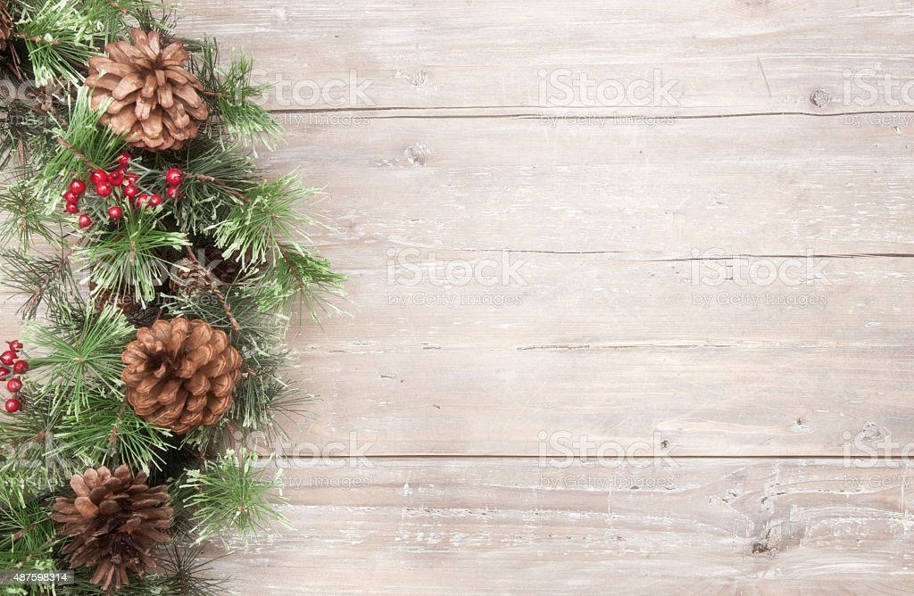 Holiday Christmas pine wreath on wood stock photo