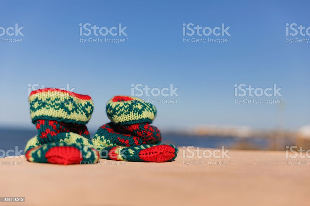 Holiday concept for New Years Cards. Christmas sock on the beach in background. Monastir, Tunisia stock photo