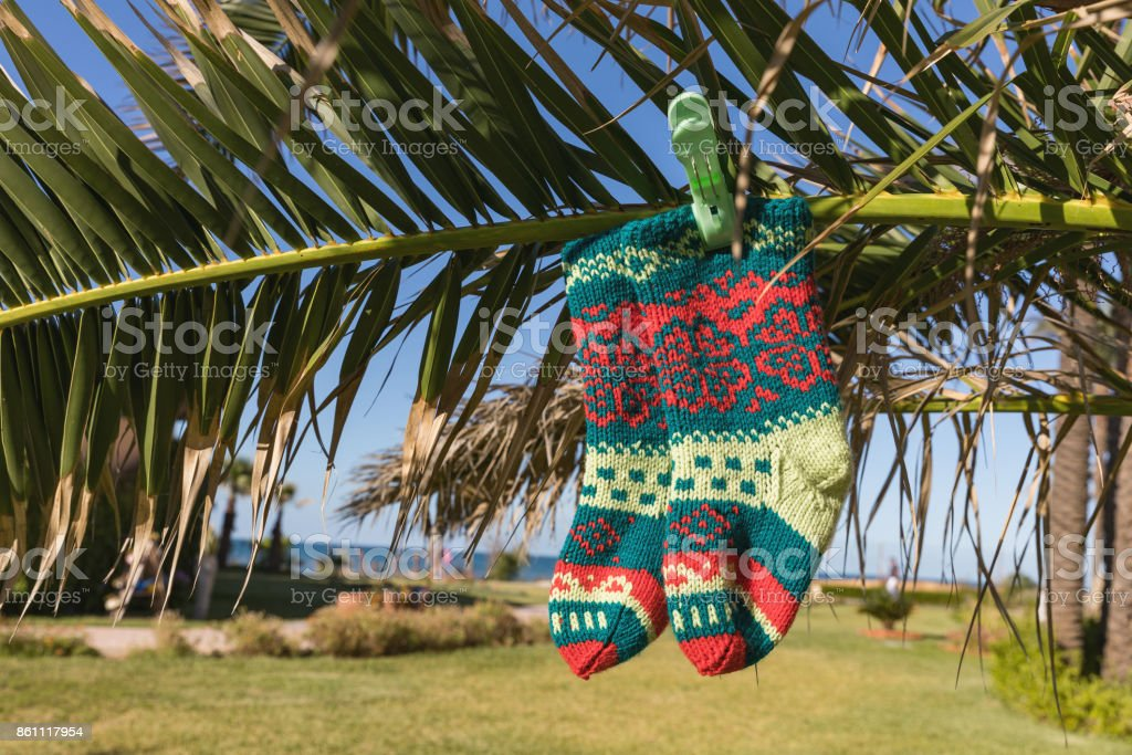 Holiday concept for New Years Cards. Christmas sock on the palm. Monastir, Tunisia stock photo