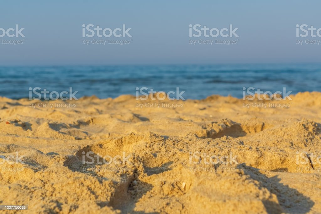Holiday concept. yellow sand in a bech . stock photo