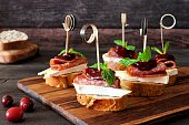 Holiday crostini skewers with cranberry sauce