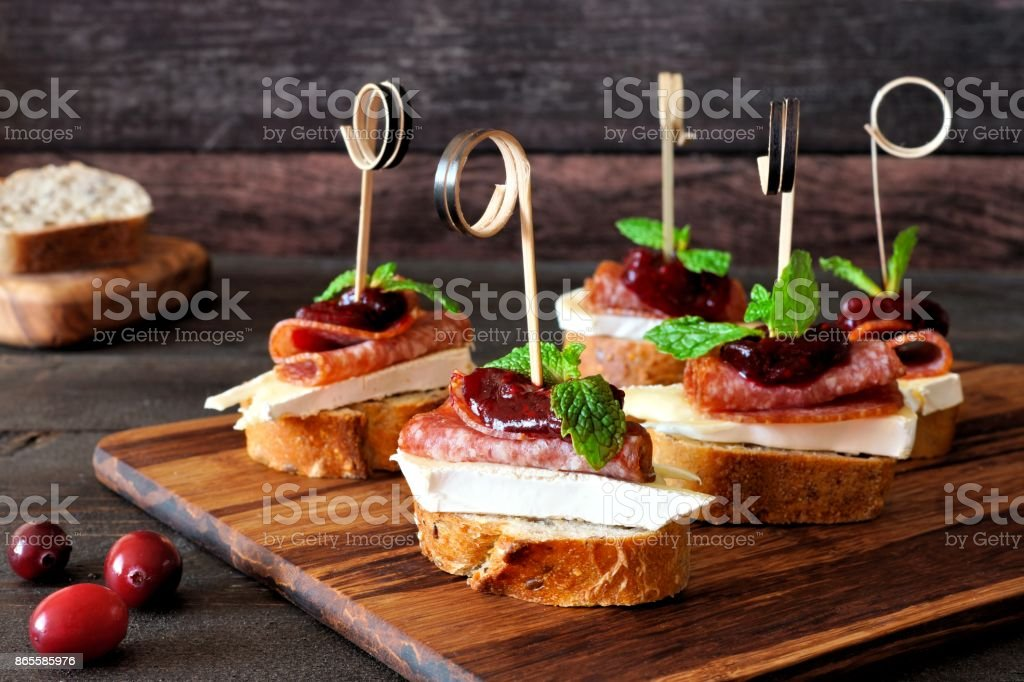 Holiday crostini skewers with cranberry sauce stock photo