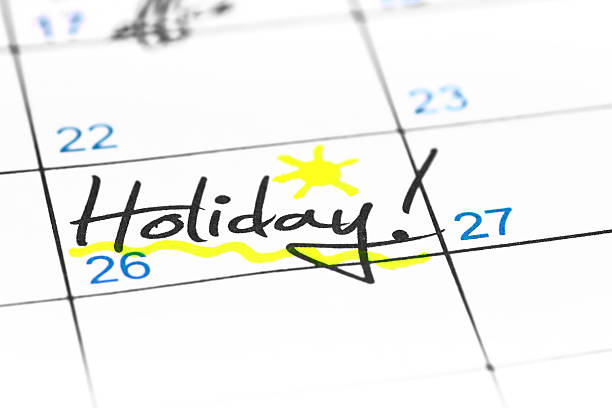 holiday date in calendar - holiday calendars stock pictures, royalty-free photos & images