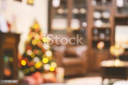 istock Holiday decorated room with Christmas tree out of focus shot for photo background 1167801837