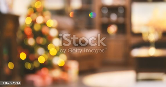 istock Holiday decorated room with Christmas tree out of focus shot for photo background 1167802741