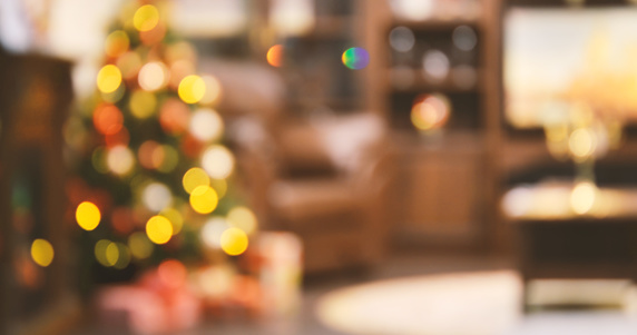 Holiday decorated room with Christmas tree out of focus shot for photo background