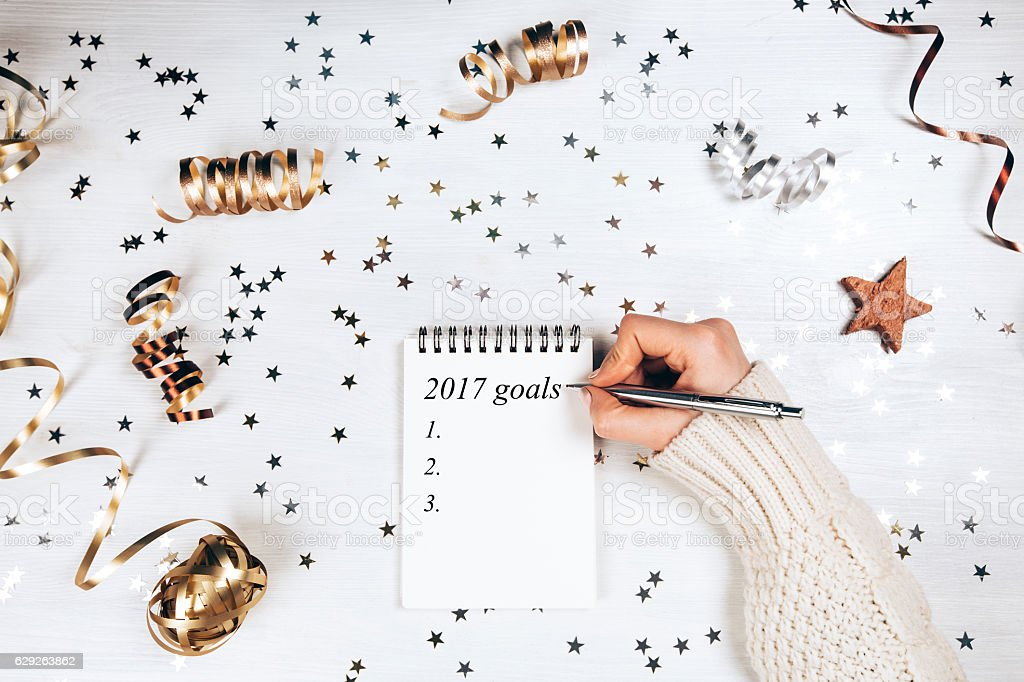 Holiday decorations and notebook with 2017 goals stock photo