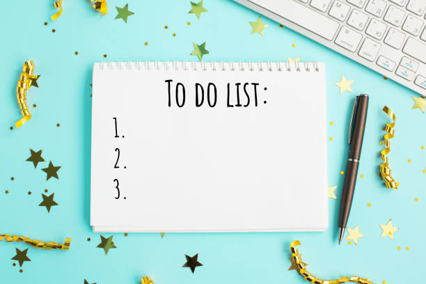 Holiday decorations and notebook with 2021 to do list. stock photo