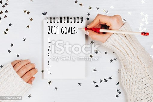istock Holiday decorations and notebook with wish list 1060233068