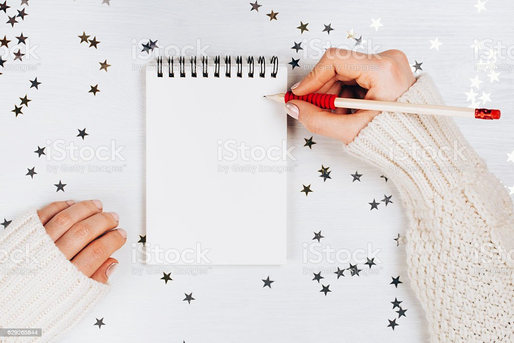 Holiday decorations and notebook with wish list stock photo