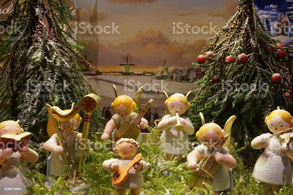 Holiday decorations. Angel miniature wooden chapel plays Christmas music. stock photo