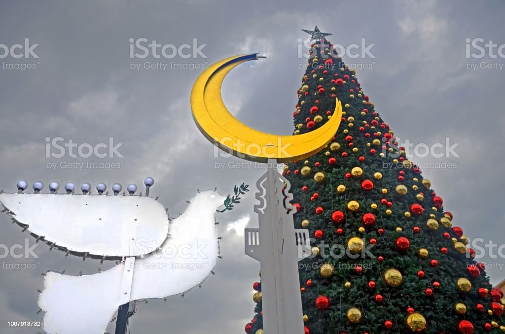 HAIFA, ISRAEL - DECEMBER 30, 2017: Holiday decorations street for holidays, Christmas tree and Hanukkah menorah in the form of a dove in Haifa, Israel stock photo
