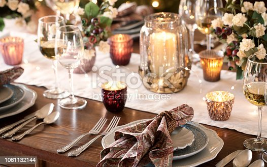 Thanksgiving or Christmas holiday elegant dining table place settings