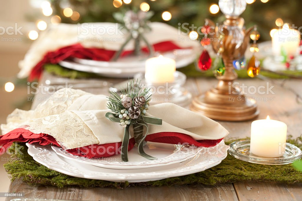 Holiday Dining Table in Front of Christmas Tree Lights