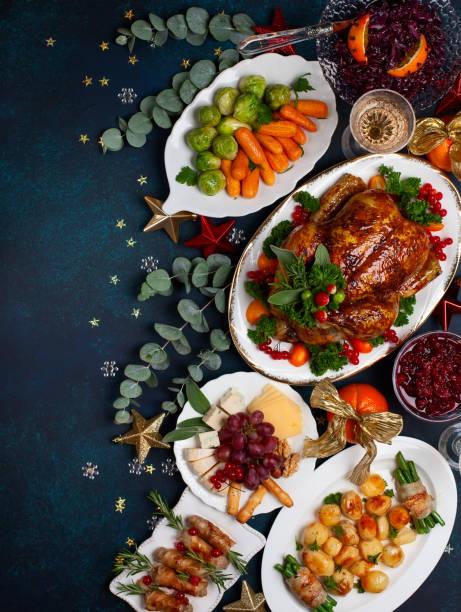 holiday dinner - cena natale foto e immagini stock
