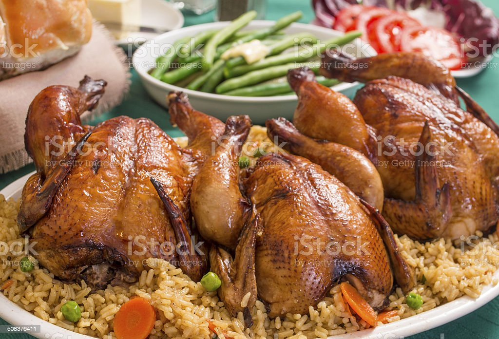 holiday dinner with cornish game hens stock photo