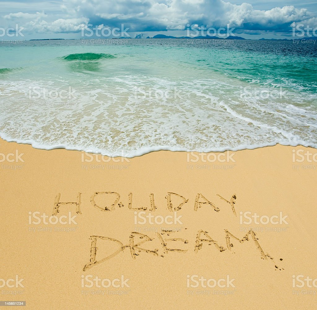 holiday dream written in a sandy tropical beach royalty-free stock photo