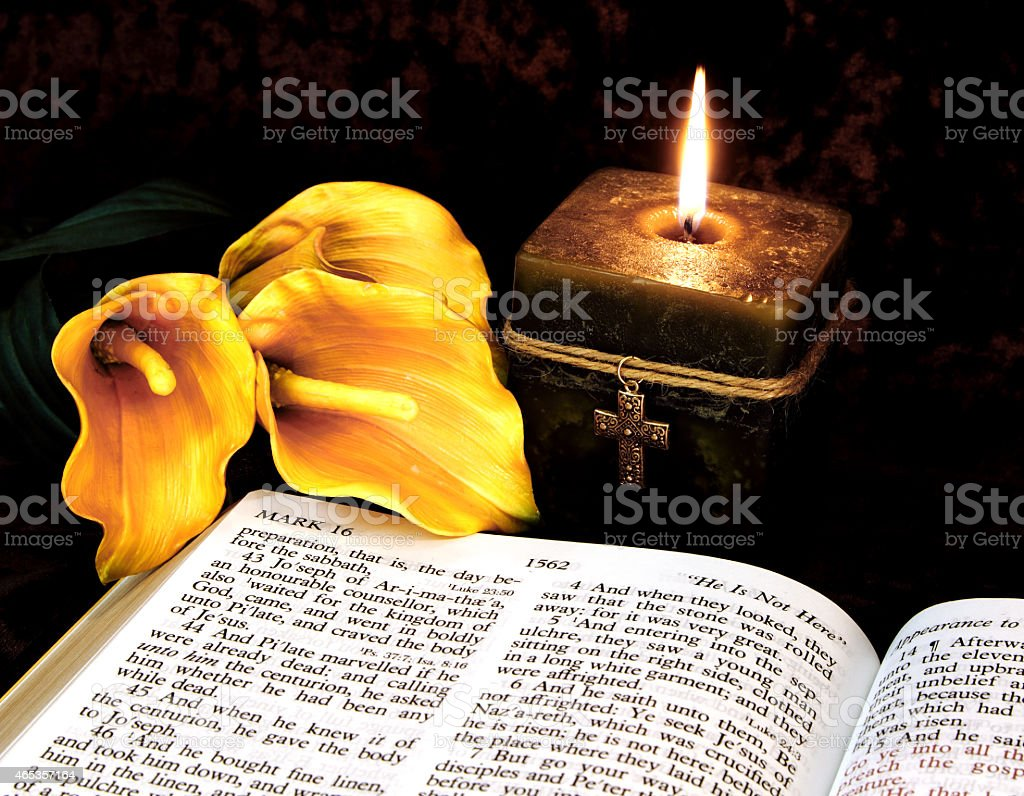 Holiday: Easter Calla Lilies, open Bible and Candle stock photo