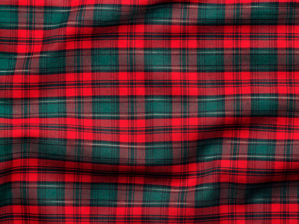 Holiday Fabric Background Red and green plaid fabric ideal for a Christmas  or Scottish theme background.To see more holiday images click on the link below: plaid stock pictures, royalty-free photos & images