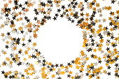 istock Holiday, festive, Christmas background. Gold, black, silver stars confetti pattern on white background top view. Copy space 1178065347