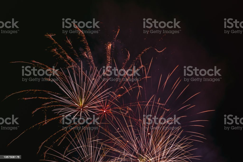 Holiday fireworks on the black sky stock photo