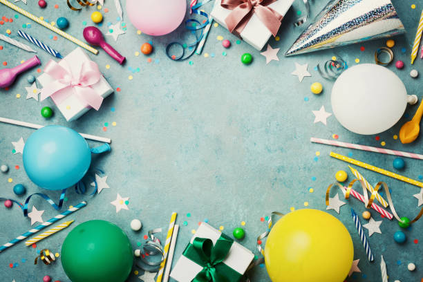 Holiday frame or background with colorful balloon, gift, confetti, silver star, carnival cap, candy and streamer. Birthday or party greeting card. stock photo