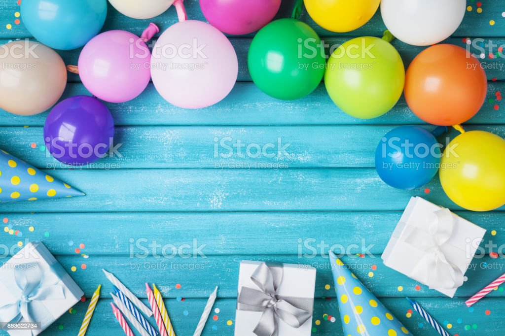 holiday frame with colorful balloons gifts confetti and carnival cap